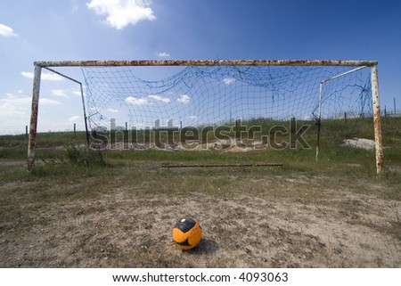 Empty goal in a abandoned field - stock photo