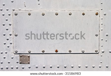 Empty gray metallic plate with copy space - stock photo
