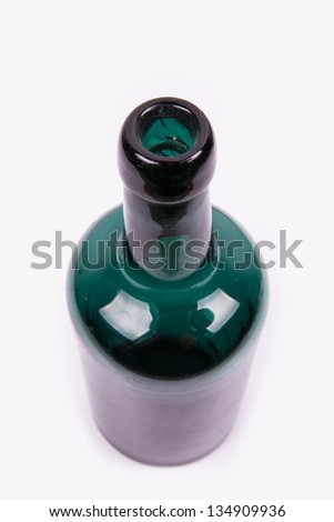 empty green bottle as seen from above with a white background