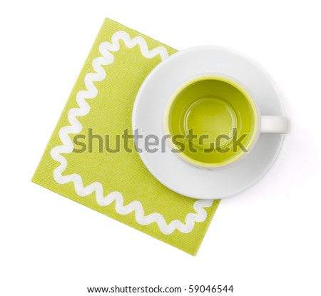 Empty green cup on green placemat. Above view. Isolated on white background - stock photo