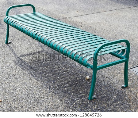 Empty green metal bench - stock photo