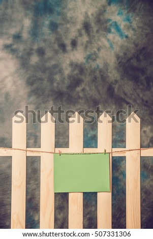 Empty greeting Christmas card on wooden fence. Christmas theme