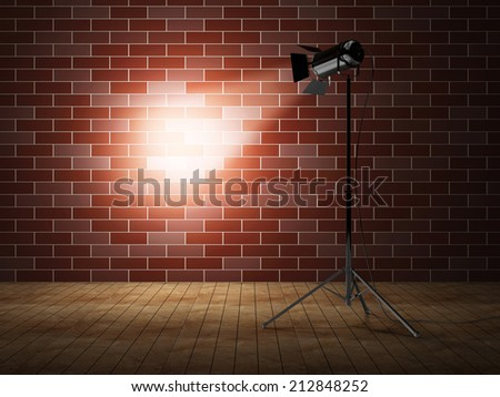 Empty Grunge Photo Studio with Brick Wall and Spotlight - stock photo