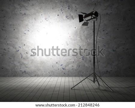 Empty Grunge Photo Studio with Concrete Wall and Spotlight - stock photo
