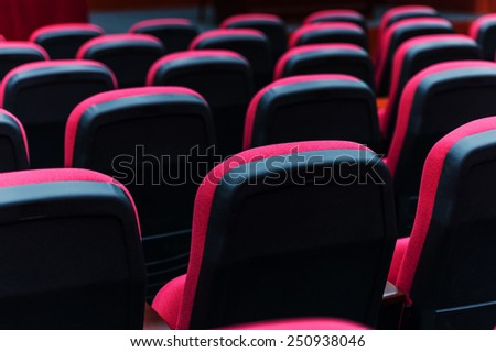 Empty hall for presentation with red armchairs. - stock photo
