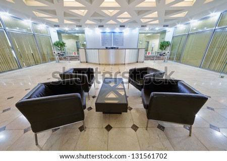 Empty hall with armchairs at business center Academicheskiy in Moscow