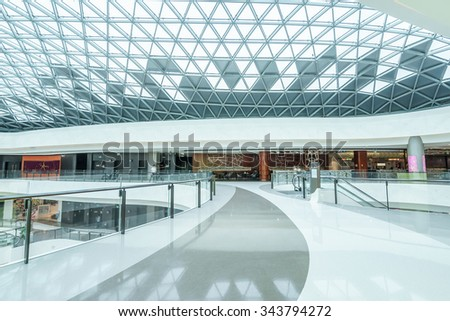 empty hallway and abstract ceiling in shopping mall - stock photo