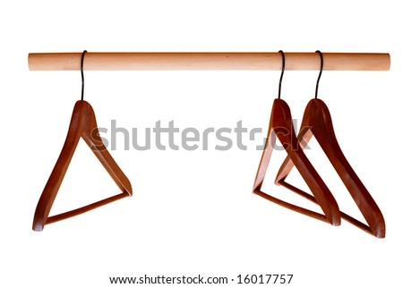 Empty hangers for clothes on rail isolated on white - stock photo