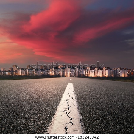 Empty highway. Entry into the city at beautiful sunset - stock photo
