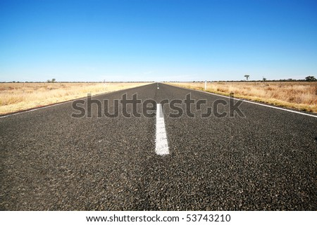 Empty highway (in outback Australia near the town of Bourke) - stock photo