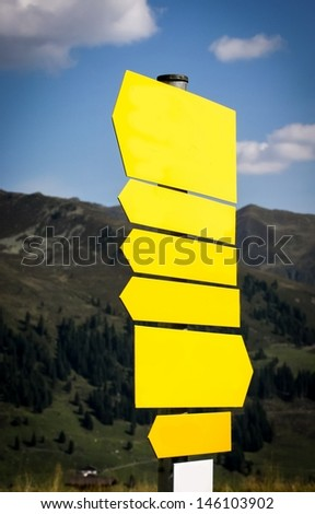 empty hiking trails sign in the mountains - stock photo