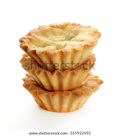 Empty homemade tartlets isolated on a white background