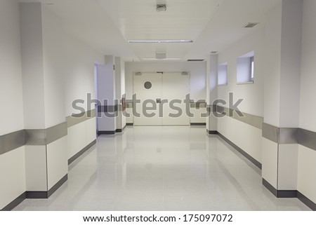 Empty hospital hall with white walls, medicine - stock photo