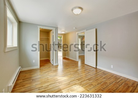Empty house interior. Bedroom with walk in closet and exit to backyard area