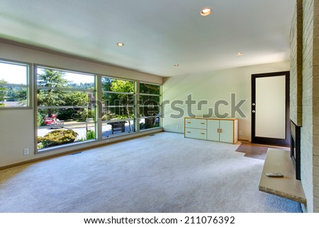 Empty house interior. Living room with glass wall and carpet floor