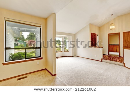 Empty house interior. Small bright room and entrance hallway