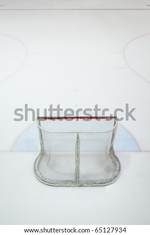 Empty ice hokey net seen from behind, nobody. - stock photo