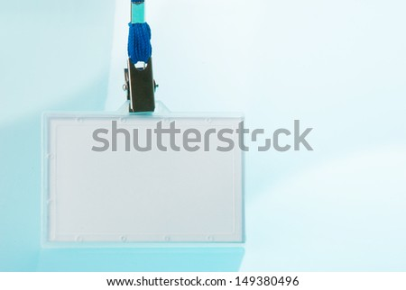 Empty identification tag on blue background