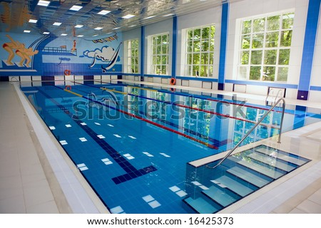 Empty indoors public swimming pool at day time - stock photo