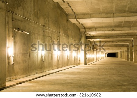 Empty industrial garage room interior with concrete floor and wall background, vintage color style - stock photo