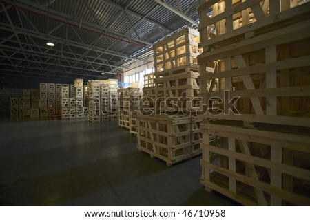 Empty industrial pallet in a warehouse - stock photo