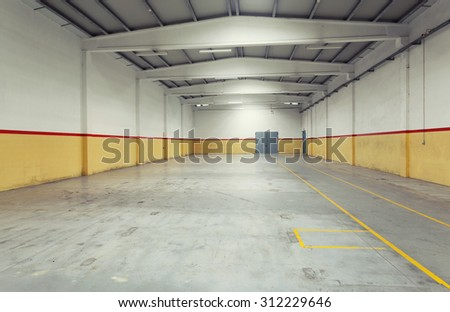 Empty industrial warehouse - stock photo