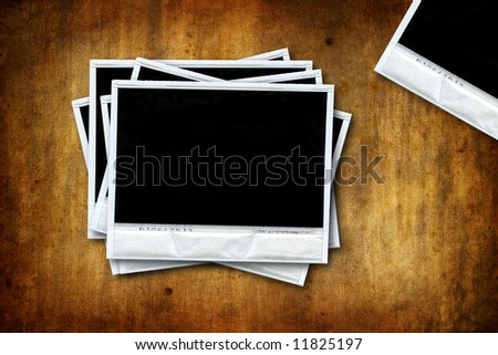 Empty instant photos on grunge background