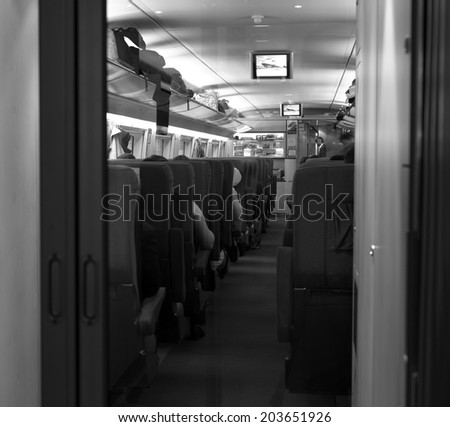 Empty interior of a passenger train car .  Public transport.  Modern train at the station - stock photo