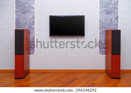 Empty interior of room with TV and speakers - stock photo