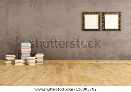 Empty interior with books on a wooden floor against a grunge wall - stock photo