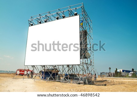 Empty Isolated billboard with the blue sky background - stock photo