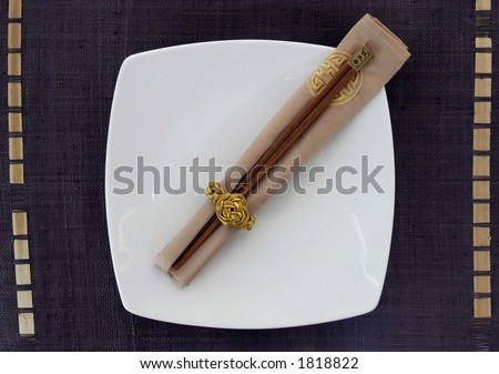Empty japanese porcelain plate with wooden sticks - stock photo