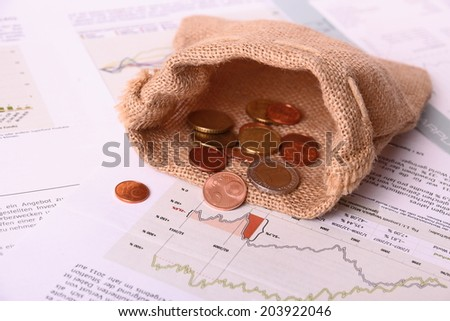 Empty jute euro sack on worthless Invest papers, close up - stock photo