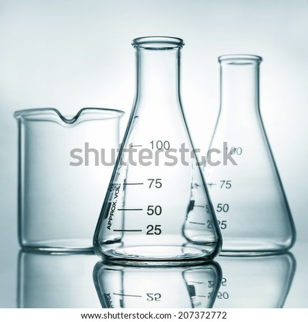 empty laboratory glassware with reflection, Blue tone - stock photo