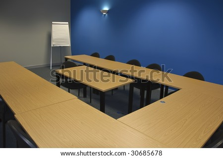 empty large modern classroom or business training meeting room - stock photo