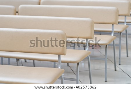 empty leather benches in audience - stock photo