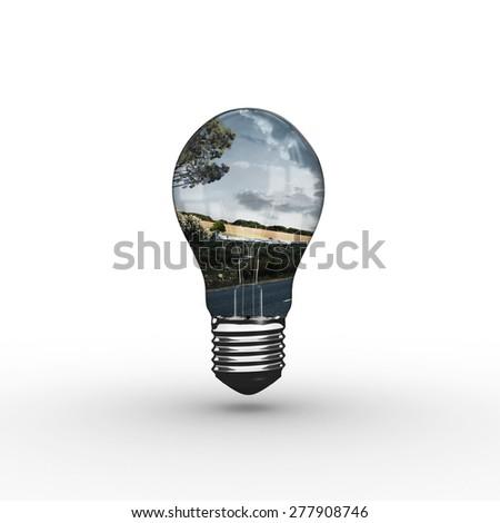 Empty light bulb against scenic backdrop - stock photo