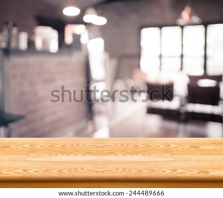 Empty light wood table top with coffee shop blur with bokeh background,Product display template. - stock photo