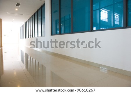 empty long corridor in a modern building. - stock photo