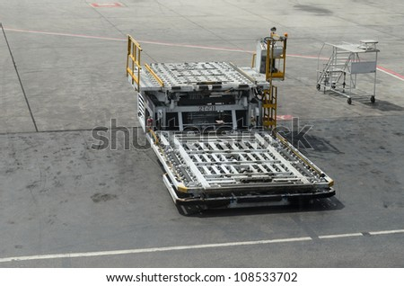 Empty luggage trolleys at airport transporting baggage - stock photo