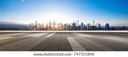 empty marble floor and cityscape of kuala lumpur at sunrise