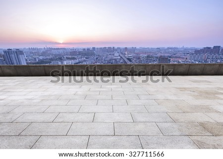 empty marble square of a modern city with skyscrapers - stock photo