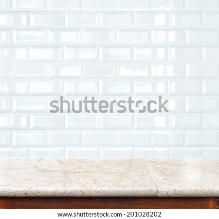 Empty marble table and ceramic tile brick wall in background. product display template. - stock photo