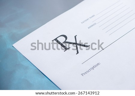 Empty medical prescription on blue reflective background - stock photo