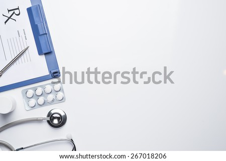 Empty medical prescription with a stethoscope on white background. Medical concept with copy space  - stock photo