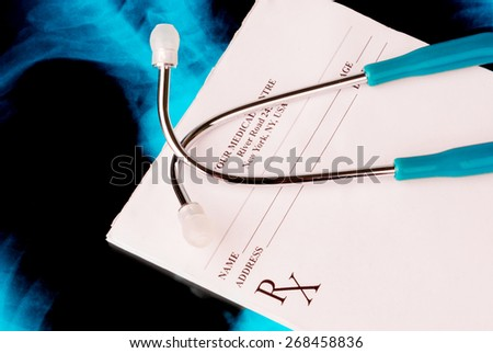 Empty medical prescription with a stethoscope on Xray photo of lungs