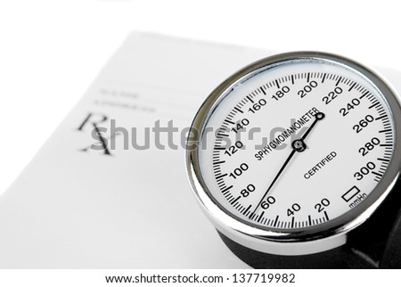 Empty medical prescription with sphygmomanometer isolated on white background