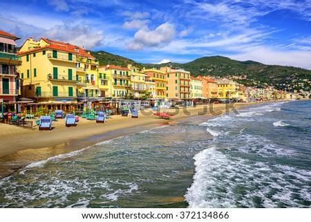 Empty mediterranean sand beach in traditional touristic town Alassio on italian Riviera by San Remo, Liguria, Italy - stock photo