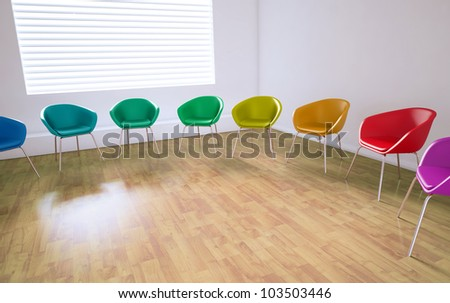 Empty meeting room with colorful chairs