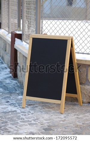 Empty menuboard on a street - stock photo
